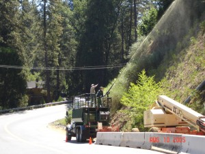 Hydroseeding the slope before laying TRM