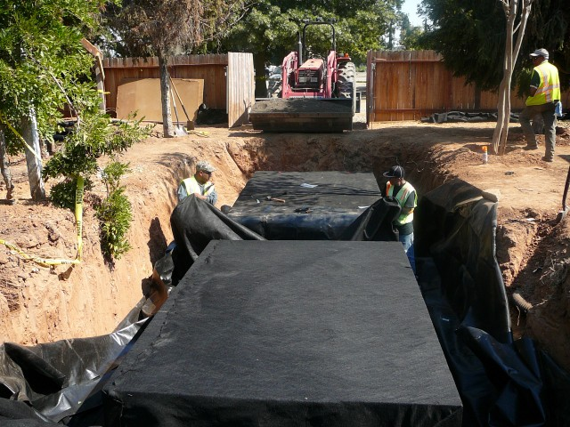 Thunder mountain enterprises inc rain water harvesting for Design of water harvesting pond